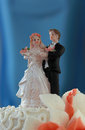 Wedding cake with figurines on blue background Stock Image