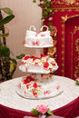 Wedding cake with figurines roses and swan Stock Images