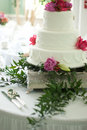 Wedding cake with flower topper Stock Image