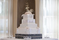 Wedding cake with flowers and table Stock Photography