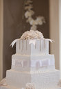 Wedding cake with flowers and table Royalty Free Stock Photography