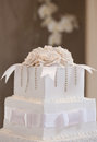 Wedding cake with flowers and table Royalty Free Stock Image