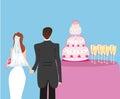 Wedding cake and a pair of honeymooners Royalty Free Stock Photo