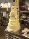Wedding cake tiered in kitchen workroom Royalty Free Stock Images