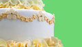 Wedding cake with yellow flowers detail of on green space for your text or logo Stock Photos