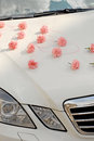 Wedding car cream color decorated with pale pink flowers for cloud reflexion in windscreen Royalty Free Stock Images