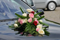 Wedding car flower bouquet on a when the bride is arriving Stock Image
