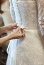 Wedding celebration ceremony morning bride dressing gown hand pr Royalty Free Stock Photo