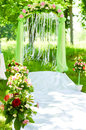Wedding ceremony arch decoration outdoor flower on summer outdoors background Stock Image