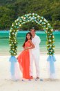 Wedding ceremony on the beach young newly married couple and details of design bouquet of frangipani seychelles Stock Images