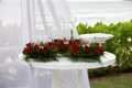 Wedding ceremony beautiful area decorated with red roses Stock Image
