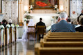 Wedding ceremony inside a church with blurry couple in background Stock Photo