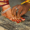 Wedding ceremony male groom holding foot ring in hindu indian Stock Images