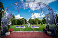 Wedding ceremony outdoors decorated arch empty chairs Royalty Free Stock Photos