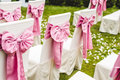 Wedding chairs with pink bows Royalty Free Stock Photo