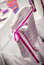 Wedding chairs purple ribbon Royalty Free Stock Image