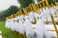 Wedding chairs with white ribbon Stock Photos