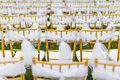 Wedding chairs with white ribbon Royalty Free Stock Photography