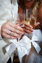 Wedding champagne glasses and bride groom hands Stock Photos