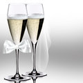 Wedding champagne glasses on the light background Royalty Free Stock Photography