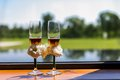 Wedding champagne glasses beside window Royalty Free Stock Photo