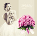 Wedding concept sitting beauty bride in white dress with shoes in her hands and pink roses bouquet Stock Images