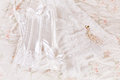 Wedding corset and veil white lace bridal on a bed Stock Photography