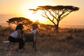 Wedding couple bridal sitting with sunset Royalty Free Stock Photo