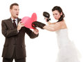 Wedding couple bride boxing heart of groom bad relationship conflict funny married wife and husband fighting isolated angry women Stock Image
