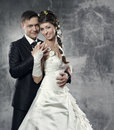 Wedding couple bride and groom over gray grunge background Royalty Free Stock Photos