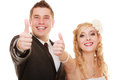 Wedding couple bride and groom showing thumb up day portrait of happy isolated on white woman girl men success sign hand Royalty Free Stock Image