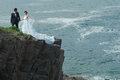 Wedding couple at cliff Stock Images