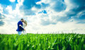 Wedding couple in the field with green grass Royalty Free Stock Photo