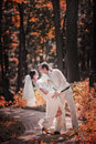 Wedding couple in a forest brown toned Royalty Free Stock Images