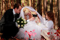 Wedding couple, girl and little dog outdoor Stock Image
