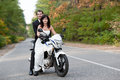Wedding couple having fun on motorcycle Stock Image