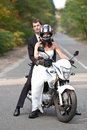Wedding couple having fun on motorcycle Royalty Free Stock Images