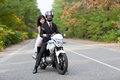 Wedding couple having fun on motorcycle Royalty Free Stock Image
