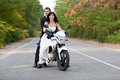 Wedding couple having fun on motorcycle Royalty Free Stock Photos
