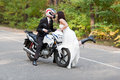 Wedding couple having fun on motorcycle Stock Images