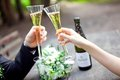 Wedding couple holding champagne glasses together Royalty Free Stock Photo