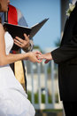 Wedding couple holding hands during the ceremony Stock Image