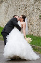 Wedding couple kiss embraced outdoors Royalty Free Stock Image