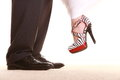 Wedding couple legs of the groom and the bride feet in footwear shoes indoor Royalty Free Stock Photo