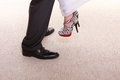 Wedding couple legs of the groom and the bride feet in footwear shoes indoor Stock Image
