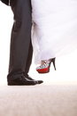 Wedding couple legs of the groom and the bride feet in footwear shoes indoor Stock Photos