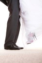 Wedding couple legs of the groom and the bride feet in footwear shoes indoor Royalty Free Stock Images