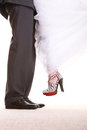 Wedding couple legs of groom and bride the the feet in footwear shoes indoor Royalty Free Stock Photography