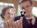Wedding couple with matching finger puppets married unique celebration on day displaying Stock Image