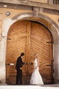 Wedding couple near an old door Stock Photography